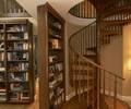 Hidden passageway behind bookshelf